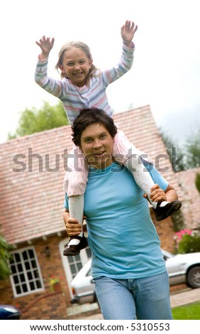 father and daugther having fun at home