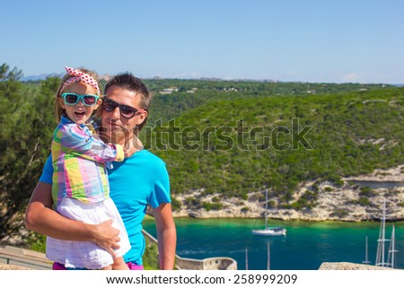 Father and her little daughter outdoors in Bonifacio city, Corsica - stock photo
