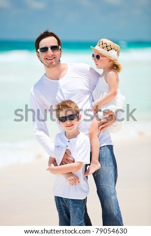 Father and his adorable kids on tropical Caribbean beach