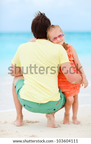 Father and his adorable little daughter at tropical beach