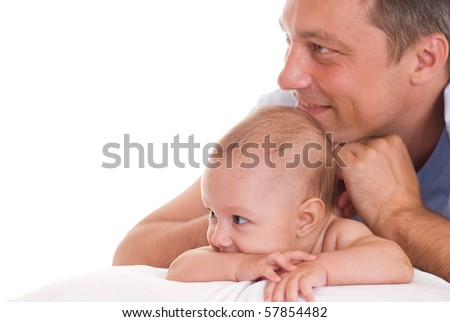 Father and his daughter sitting at the wite desk - stock photo