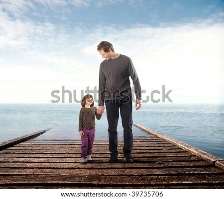 father and his little daughter  on a wharf - stock photo