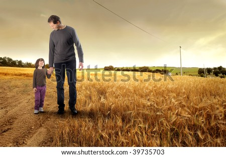 father and his little daughter  walking in the countryside - stock photo