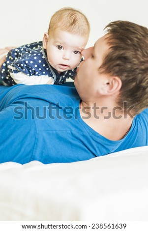 Father and His Newborn Child Together. Indoors shot. Vertical Image - stock photo