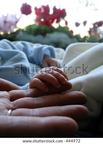 Father and his newborn daughter - stock photo