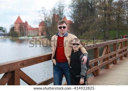 Father and his small son are going to visit Trakai Castle, Lithuania - stock photo