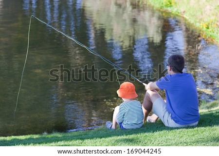 father and his son fishing together