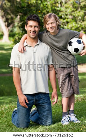 Father and his son in the park - stock photo