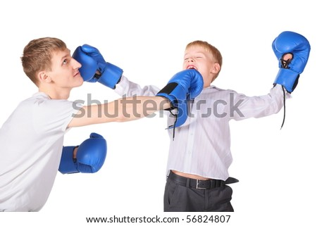 father and his son is boxing with boxing gloves. father is giving a slap to boy's face. - stock photo
