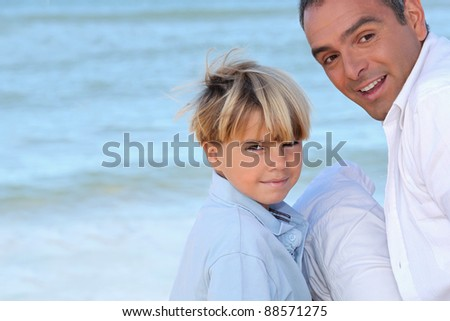 father and his son near the sea - stock photo