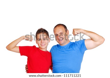 Father and his son showing muscles - stock photo