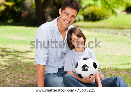 Father and his son with their ball - stock photo