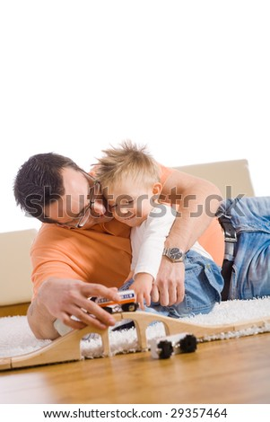 Father and kid having fun together at home. - stock photo