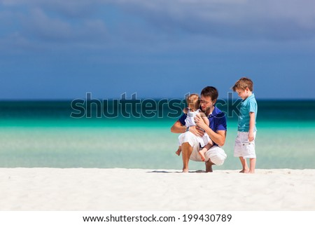 Father and kids at tropical beach during summer vacation