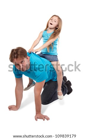 Father and little daughter play horse-ride - stock photo