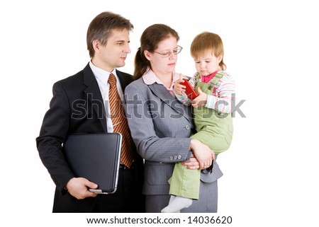 father and mother dressed for business with child - stock photo