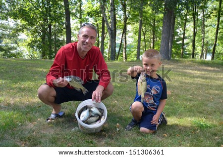 father and son after fishing - stock photo