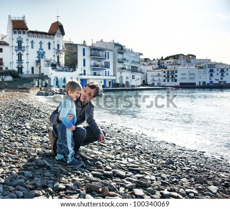 Father and son against Cadaque?s view - stock photo
