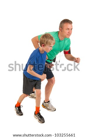 Father and son are running together - stock photo