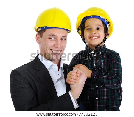 Father and son as engineers - stock photo