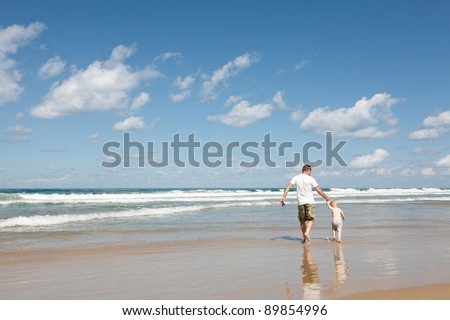 Father and son at sea - stock photo