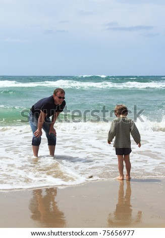 father and son at sea, spring - stock photo