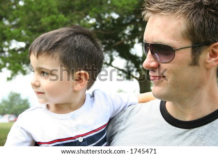 Father and son at the park. - stock photo