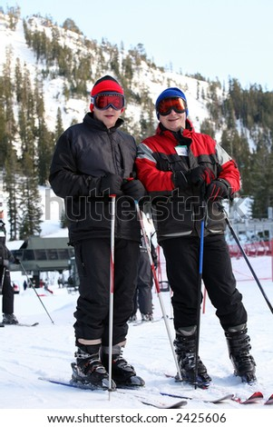 Father and son at the ski resort - stock photo