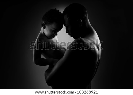 Father and son,  black and white image - stock photo
