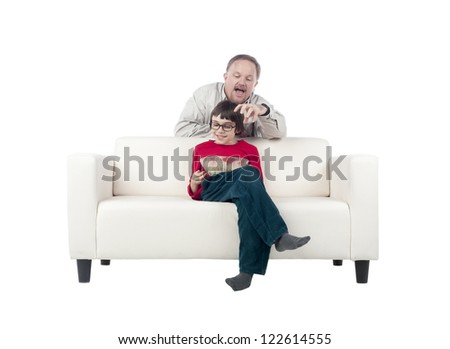 Father and son bonding on a sofa