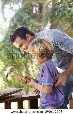 Father And Son Building Tree House Together - stock photo