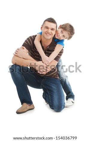 Father and son. Cheerful father and son standing close to each other and smiling while isolated on white - stock photo