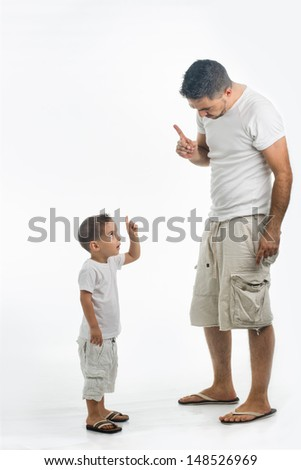 Father and son dare each other for punishment - stock photo