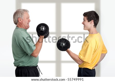 Father and son doing weight lifting together - stock photo