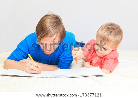 father and son drawing together, early learning