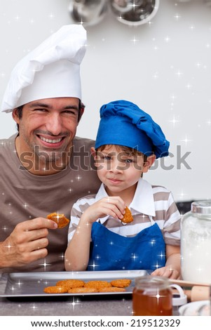 Father and son eating biscuits in the kitchen with twinkling stars - stock photo