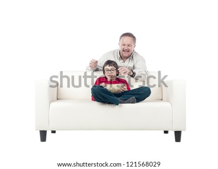 Father and son eating popcorn on couch
