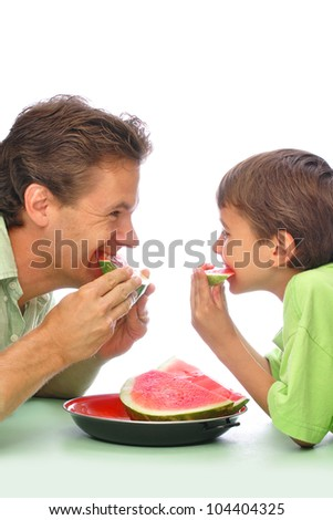 Father and son eating sliced watermelon together with white background