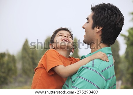 Father and son enjoying outdoors - stock photo