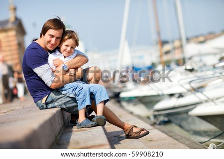 Father and son enjoying summer day in city - stock photo