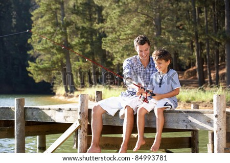 Father and son fishing together - stock photo