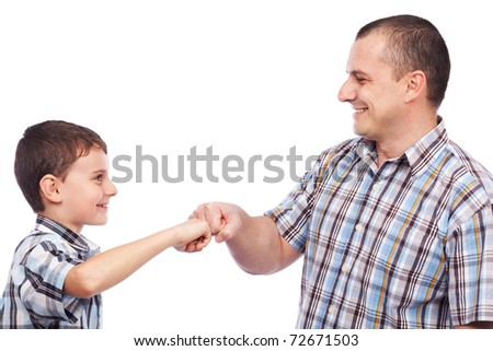 Father and son giving a hip-hop salute - stock photo