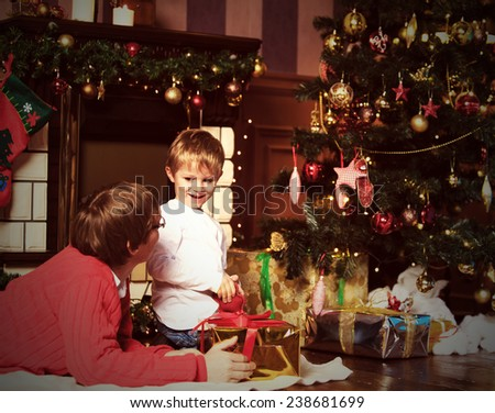 father and son giving presents on Christmas at home