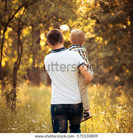 Father and son go away - stock photo