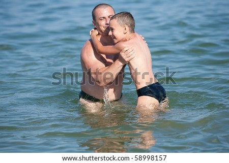 Father and son having a good time at the sea