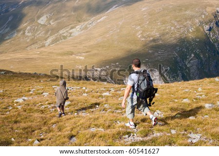 Father and son having a great time in the mountains - stock photo