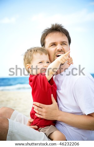 Father and son having fun on the beach.