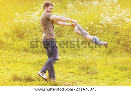 Father and son having fun outdoors in sunny summer day - stock photo