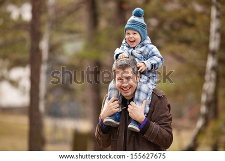 Father and son having fun outdoors, shallow depth of field - stock photo