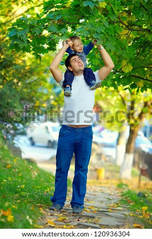 father and son having fun playing outdoors